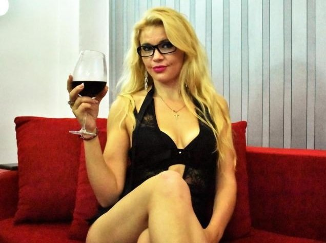 Blond transsexual LalaineTS loves a glass of wine