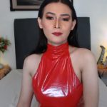 Ts princess in her red latex dress