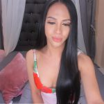 The handsome ladyboy Julia quietly smokes a cigarette