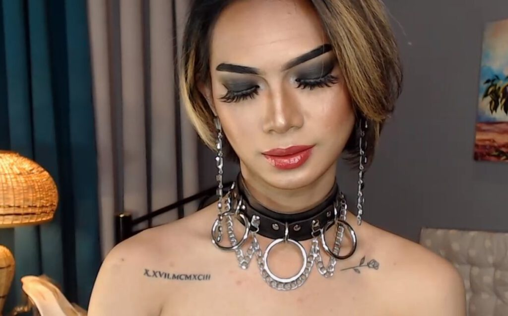 Handsome Transwoman in latex clothing